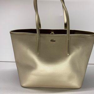 Lacoste gold purse